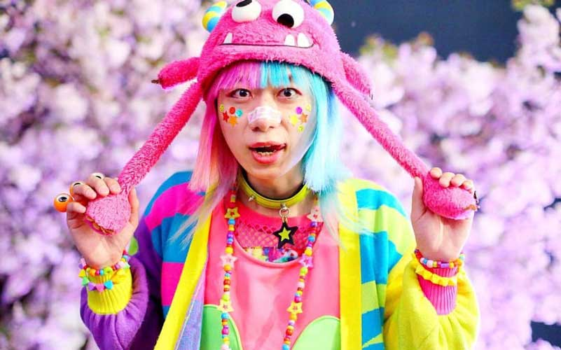 J Fashion Decora brightly dressed man in fun, children's clothes